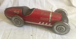 vintage mettoy tin plate clockwork racing car , working
