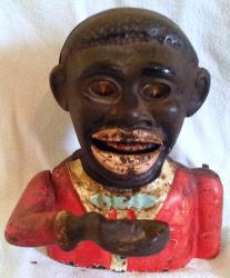genuine vintage cast iron jolly negro mechanical moneybox with rolling eyes