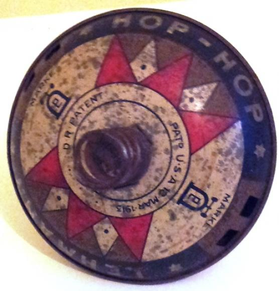1913 german lehmann c/w tin plate hop hop spinning top.